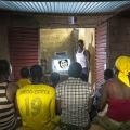 Jean-Francis Kyelem, Koupela, quartier Rondin. Burkina Faso. policier de son Il a monté un club vidéo devant sa maison depuis qu'il a acheté un kit solaire.